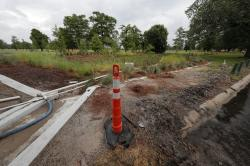 """In this Friday, May 15, 2020 photo, a recently completed """"bioswale"""" is seen at Prentiss Ave. and Press Drive in New Orleans"""