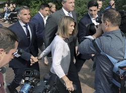 Lori Loughlin departs federal court with her husband, clothing designer Mossimo Giannulli, left, in Boston, after a hearing in a nationwide college admissions bribery scandal.