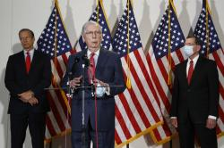 Senate Majority Leader Mitch McConnell of Ky., speaks with reporters after meeting with Senate Republicans at their weekly luncheon on Capitol Hill in Washington, Tuesday, May 19, 2020