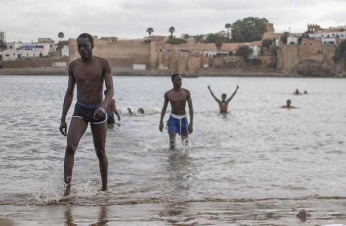 People gather at a reopened beach on the first weekend after lockdown measures were lifted in Sale, Morocco.