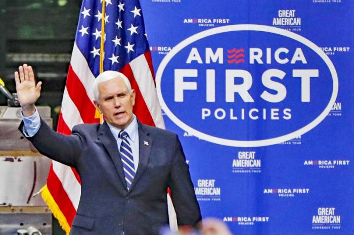 In this June 12, 2020, file photo Vice President Mike Pence, waves as he arrives to speak after a tour at Oberg Industries plant in Sarver, Pa.