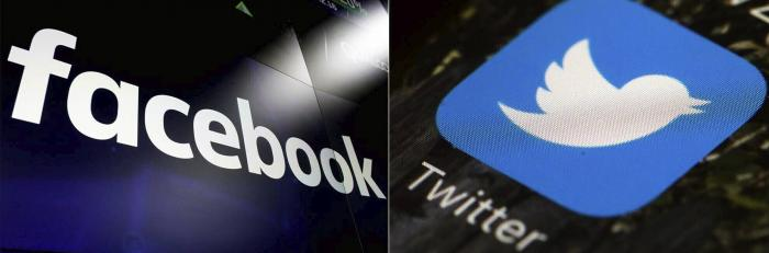 Logos for social media platforms Facebook and Twitter.