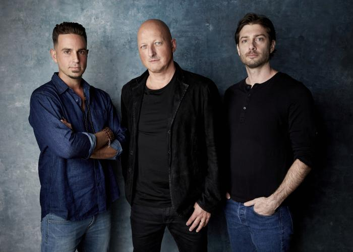 """James Safechuck, from right, director Dan Reed and Wade Robson pose for a portrait to promote the film """"Leaving Neverland"""" during the Sundance Film Festival."""