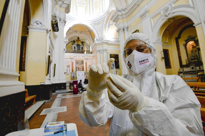 A medical operator prepares to perform COVID-19 test swabs in the Church of San Severo Outside the Walls, in the heart of Naples, Italy.