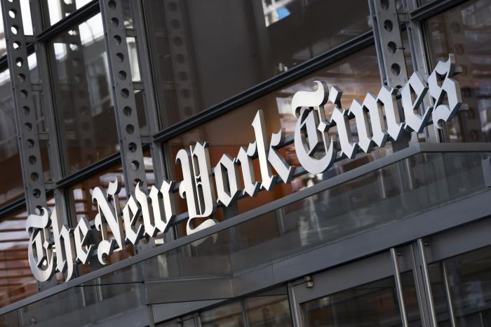 A sign for The New York Times hangs above the entrance to its building, in New York.