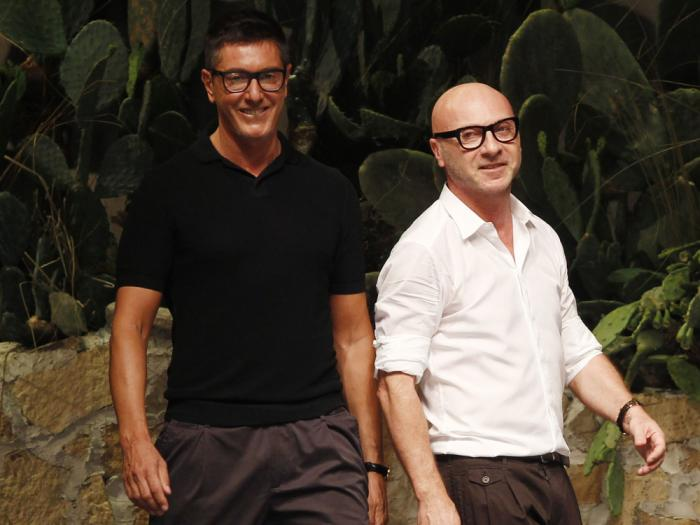 In this June 23, 2012 file photo Italian fashion designers Stefano Gabbana, left, and Domenico Dolce take the catwalk after presenting their Dolce & Gabbana men's fashion collection in Milan, Italy