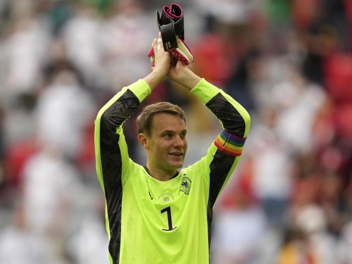 Germany's goalkeeper Manuel Neuer celebrates with fans after the Euro 2020 soccer championship group F match between Portugal and Germany in Munich, Saturday, June 19, 2021