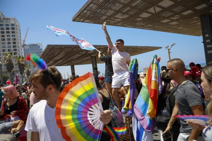 People participate in the annual Pride Parade, in Tel Aviv, Israel, Friday, June 25, 2021.