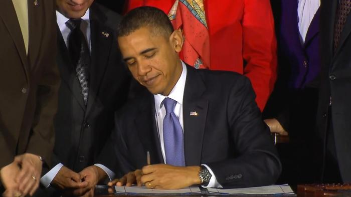 President Obama signs to repeal Don't Ask, Don't Tell on December 22, 2010.