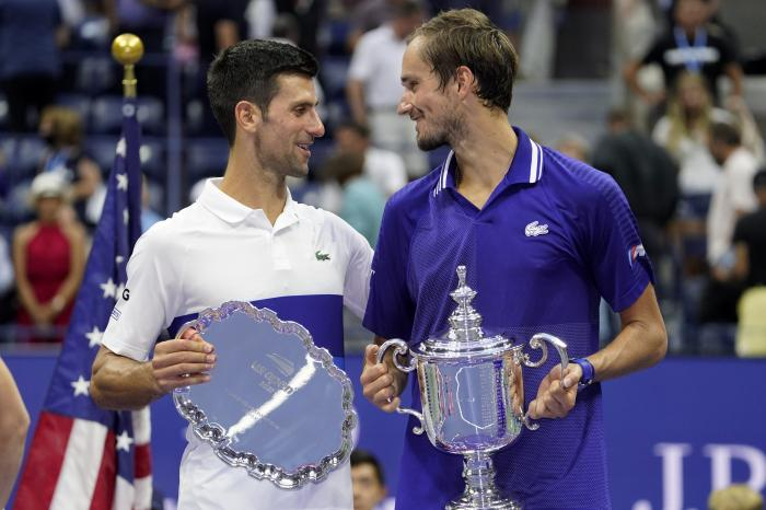Novak Djokovic, of Serbia, left, and Daniil Medvedev, of Russia, talk during the trophy ceremony after the men's singles final of the US Open tennis championships in New York.