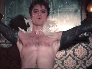 Watch: Daniel Radcliffe in Leather Chaps Singing 'She'll Be Coming Round the Mountain'